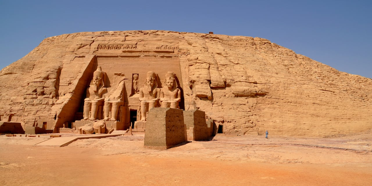 The large Egyptian sculptures carved into the side of a rock at the entrance to a temple in Abu Simbel, Egypt