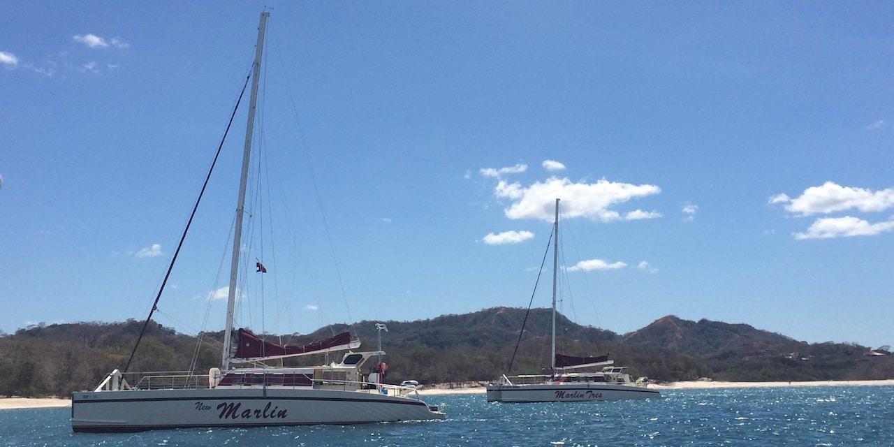 Two Marlin catamaran boats drift across the sea