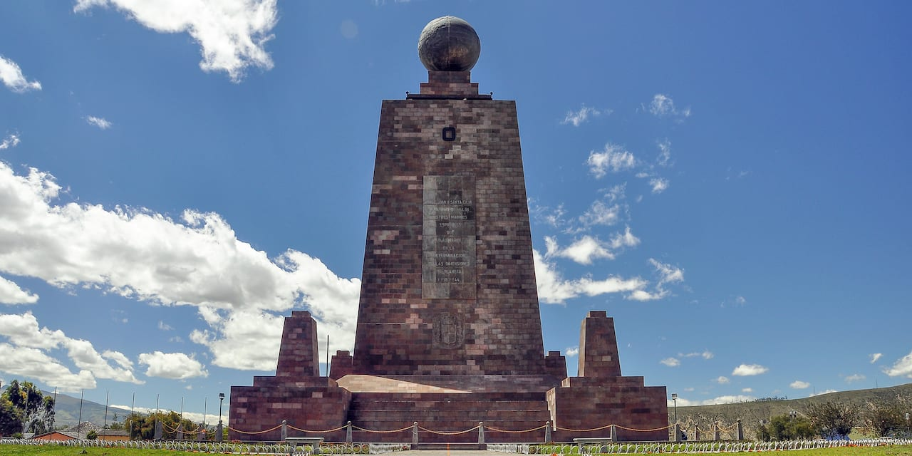 A row of busts lines a path to the Monument to the Equator at Ciudad Mitad del Mundo in Equador