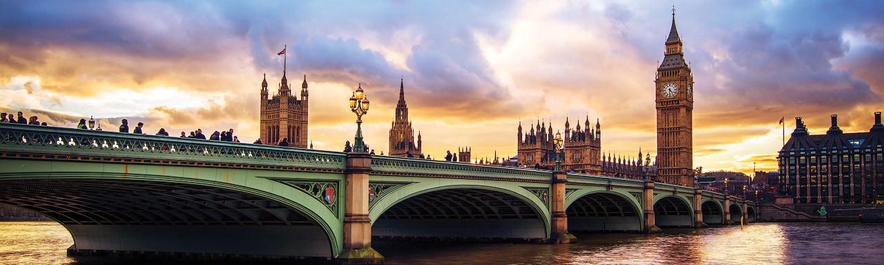 The River Thames flows under London Bridge near Big Ben