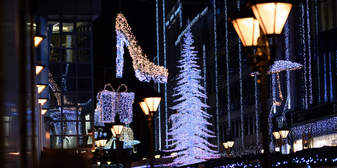 Buildings and trees in Budapest are decorated with holiday lights, including one shaped like a stiletto shoe and one shaped like a wrapped gift