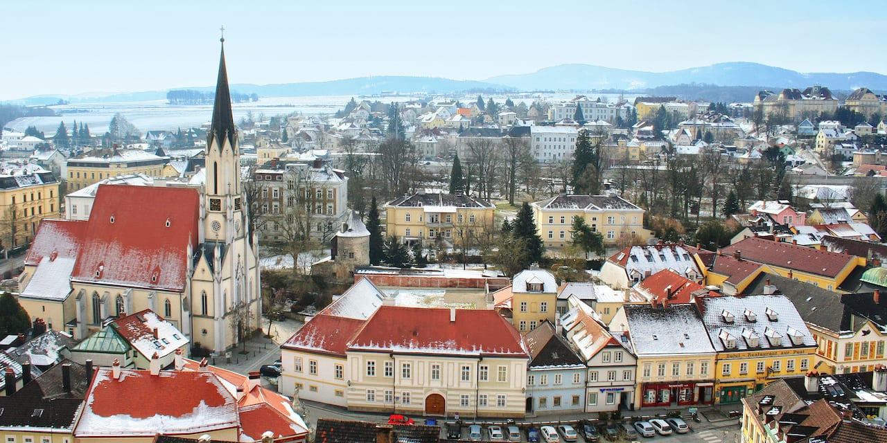 The quaint city of Melk with a steepled church and roofs lightly dusted with snow