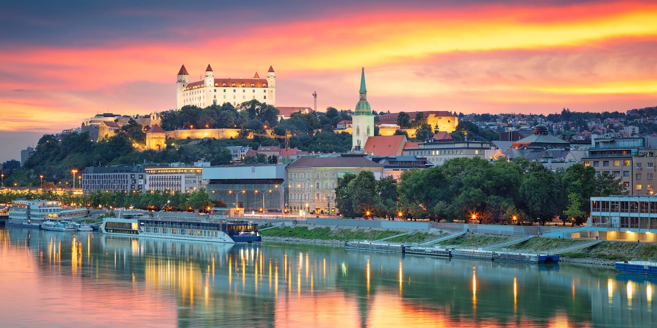 Sunset reflecting on the Danube River with Schloss Hof Palace on the hill overlooking the city below