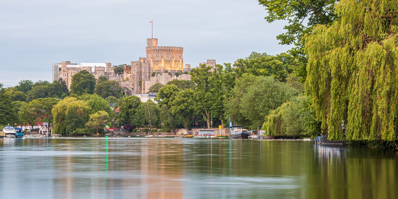Lush foliage and the River Thames surround Windsor Castle