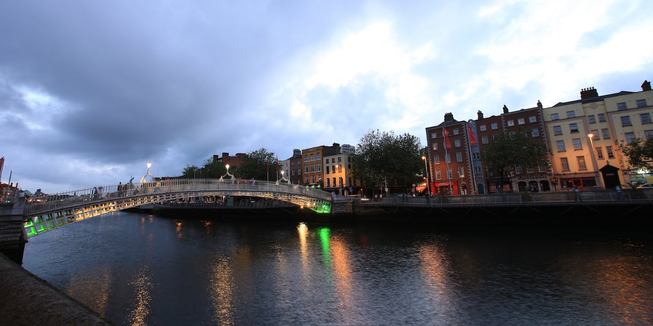 A river and small bridge in an old European city