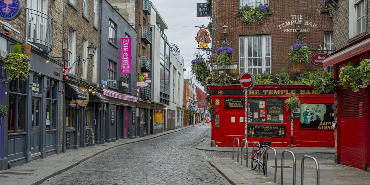 Shops line a cobblestone street