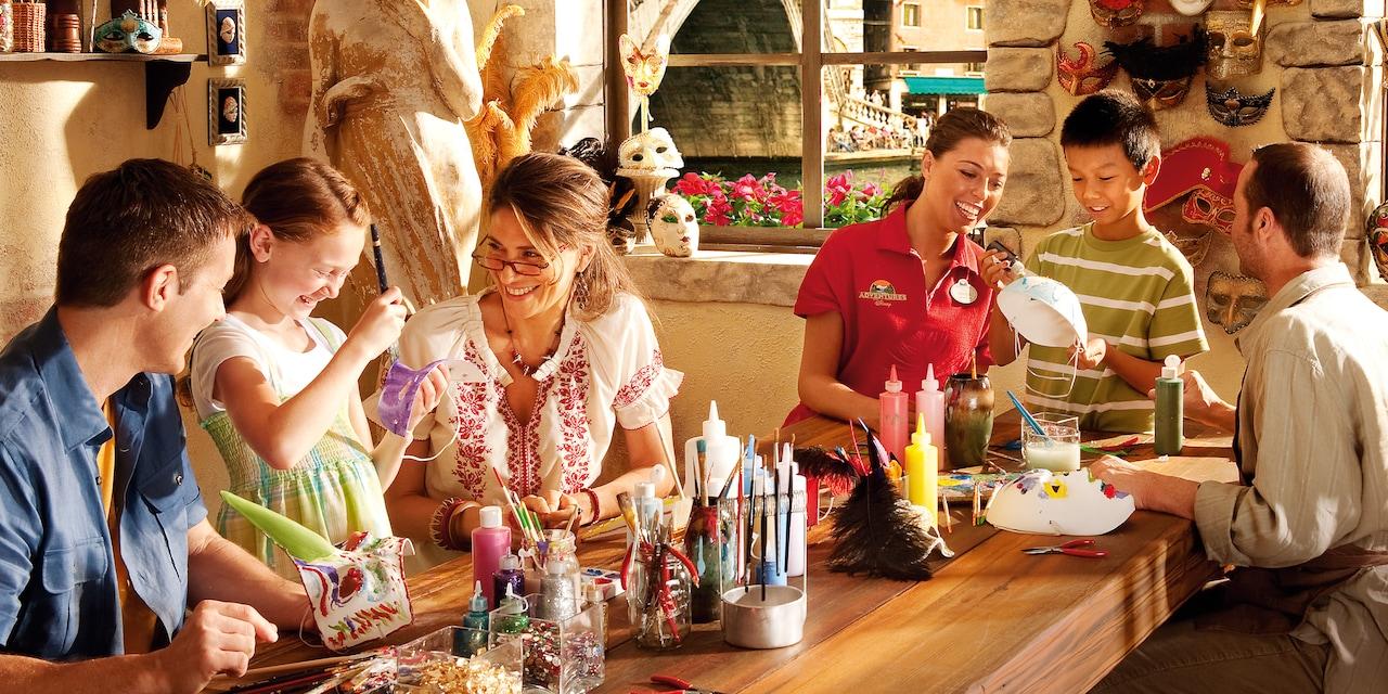 A family enjoys Venetian mask-making