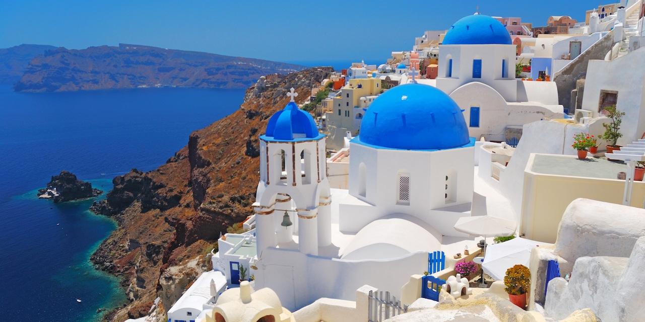 Buildings built into the cliffs of Santorini, Greece overlooking the Aegean Sea