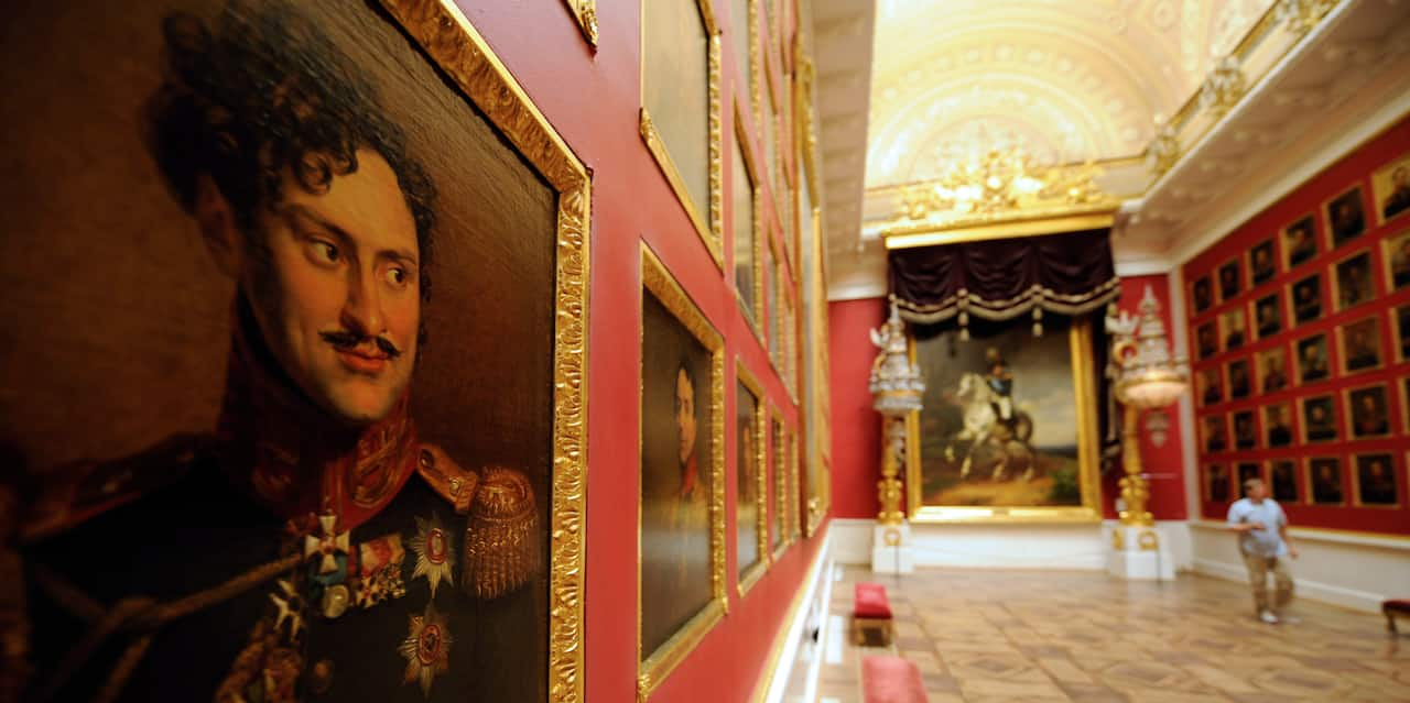 A portrait of a mustached military man on a wall lined with painted portraits in a gallery room in the Hermitage Museum