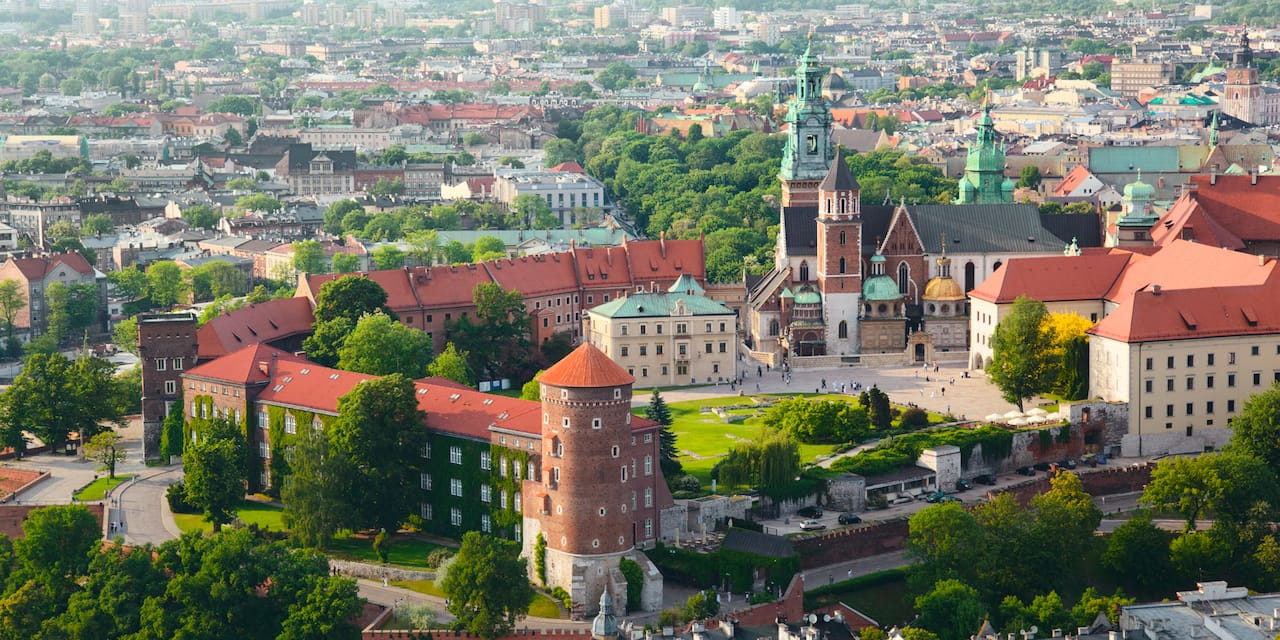 An aerial view of Krakow, Poland with Wawel Castle and Wawel Cathedral in the foreground