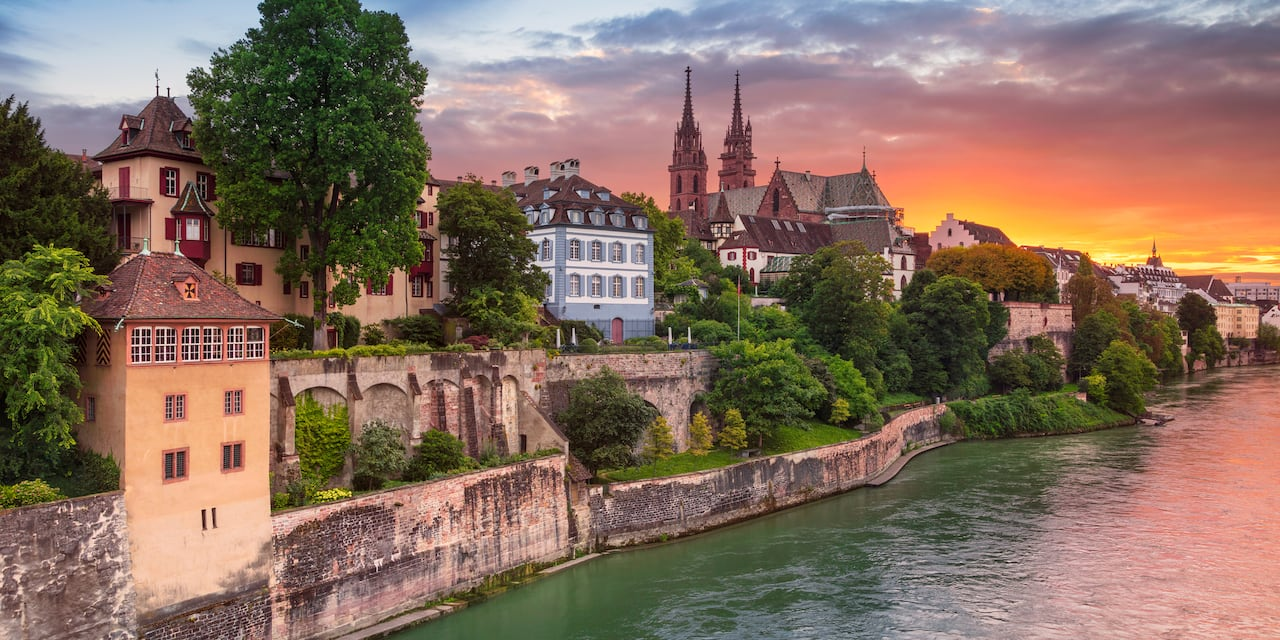 Basel Switzerland skyline at sunset overlooking the Rhine River