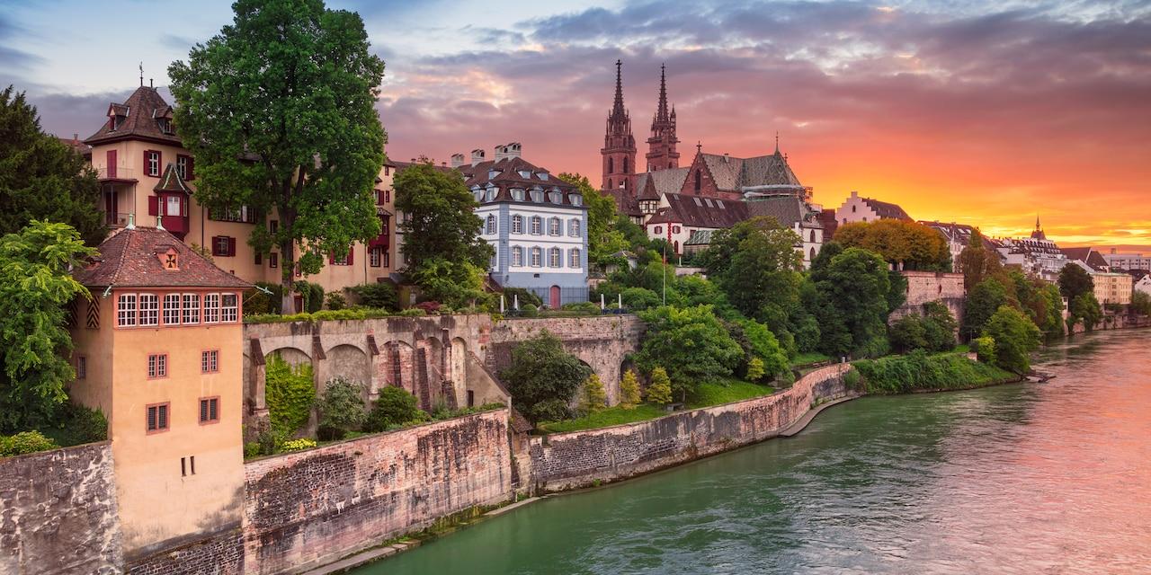 Basel Switzerland skyline at sunset overlooking the Rhine River