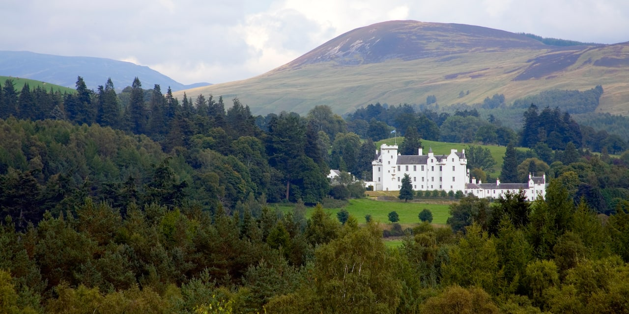 Blair Castle is nestled among the trees and hills