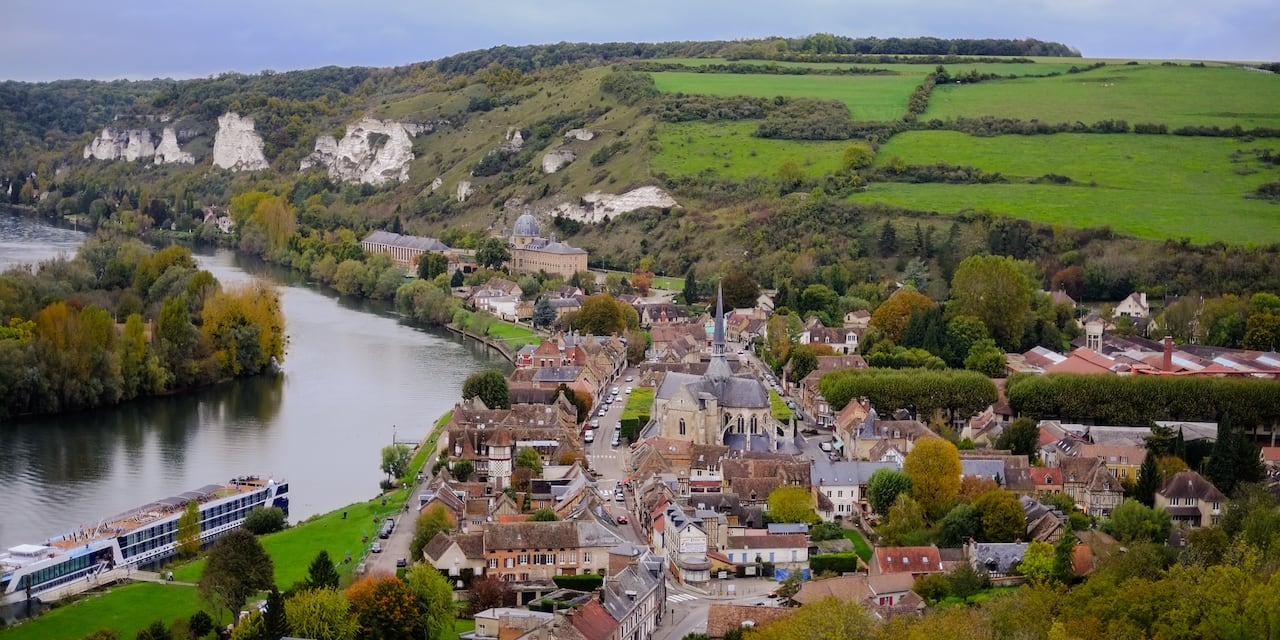 The town of Rouen, France and its white cliffs along the riverbank of the Seine River