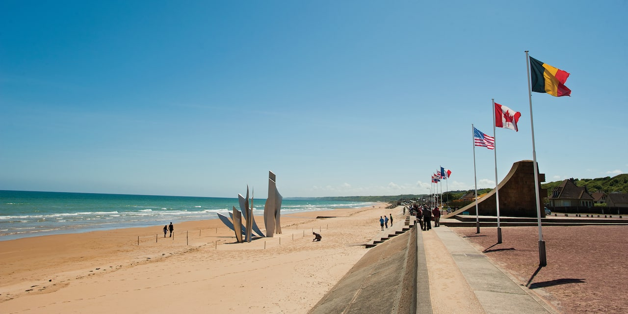 Flags of many nations fly near Les Braves Memorial of Omaha Beach in Normandy, France