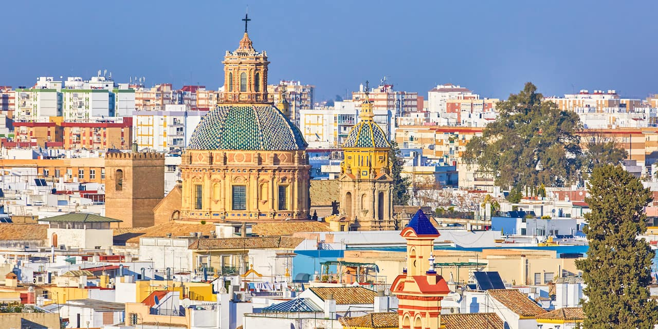 The city of Seville, Spain with a large, ornate church
