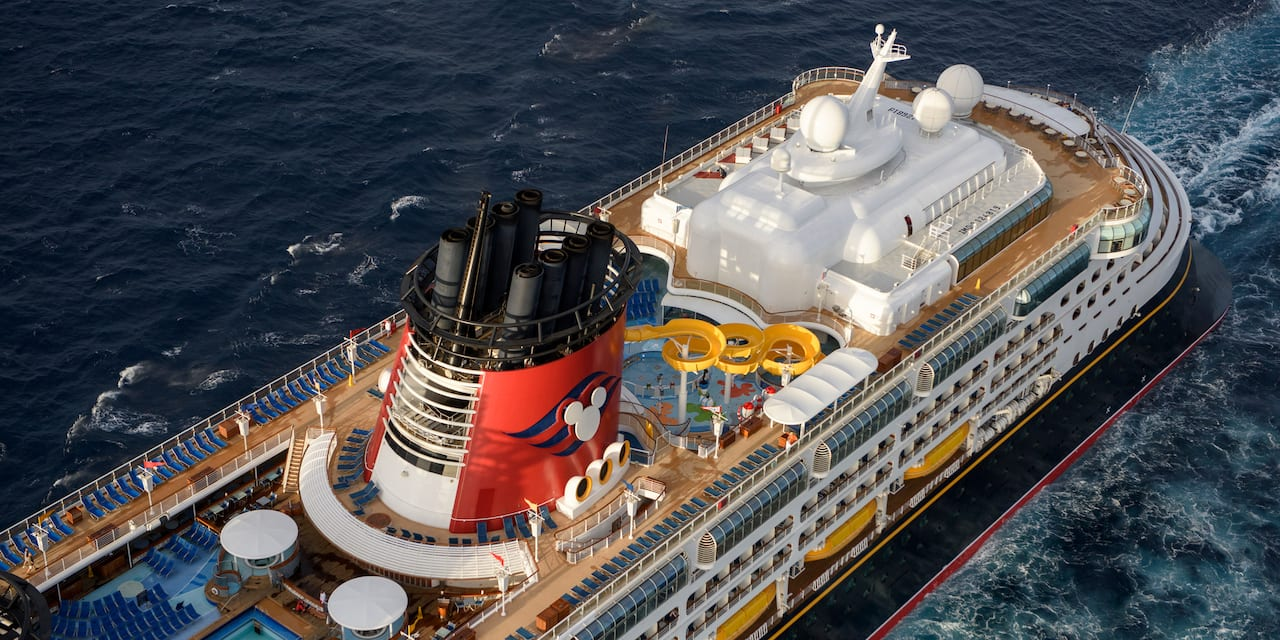 A birds-eye view of the top deck of the Disney Wonder cruise ship as it sails across the sea