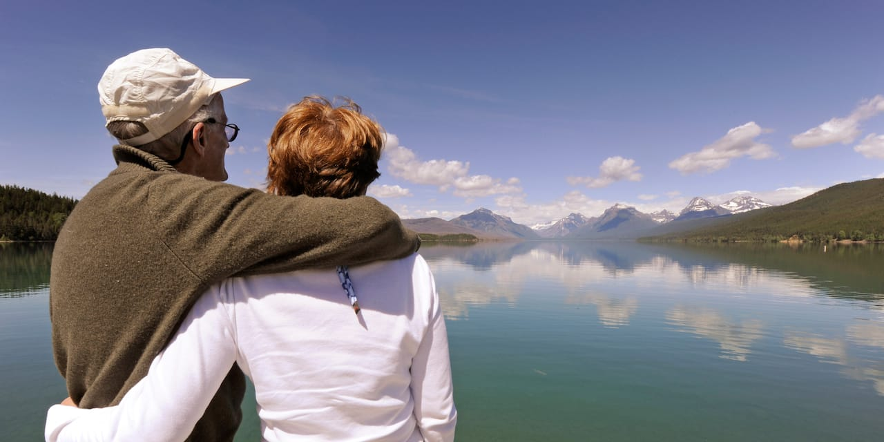 A couple takes in beautiful lake and mountain views