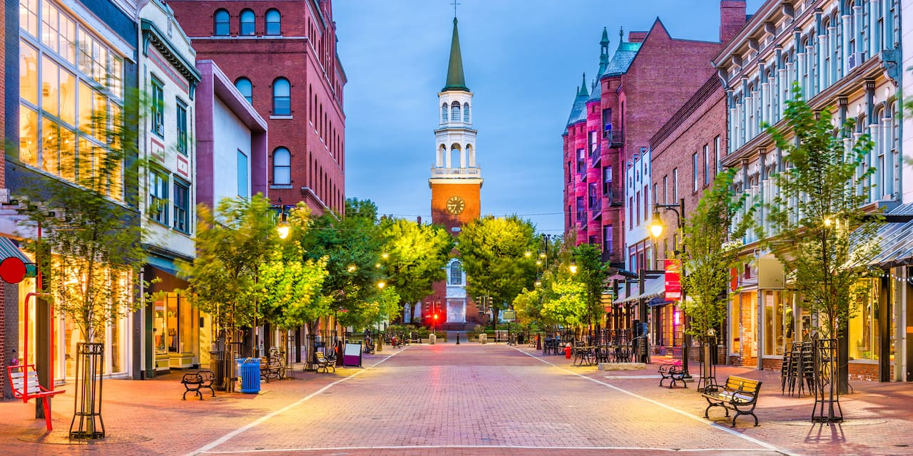 A shop-lined brick road in Burlington, Vermont dead ends at a church with a tall steeple