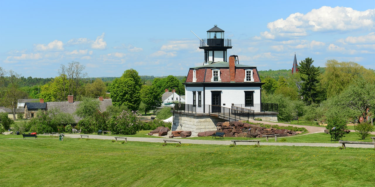 The Colchester Reef Lighthouse on the lush, grassy grounds of the Shelburne Museum