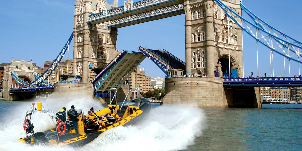 A speedboat races towards Tower Bridge on the River Thames