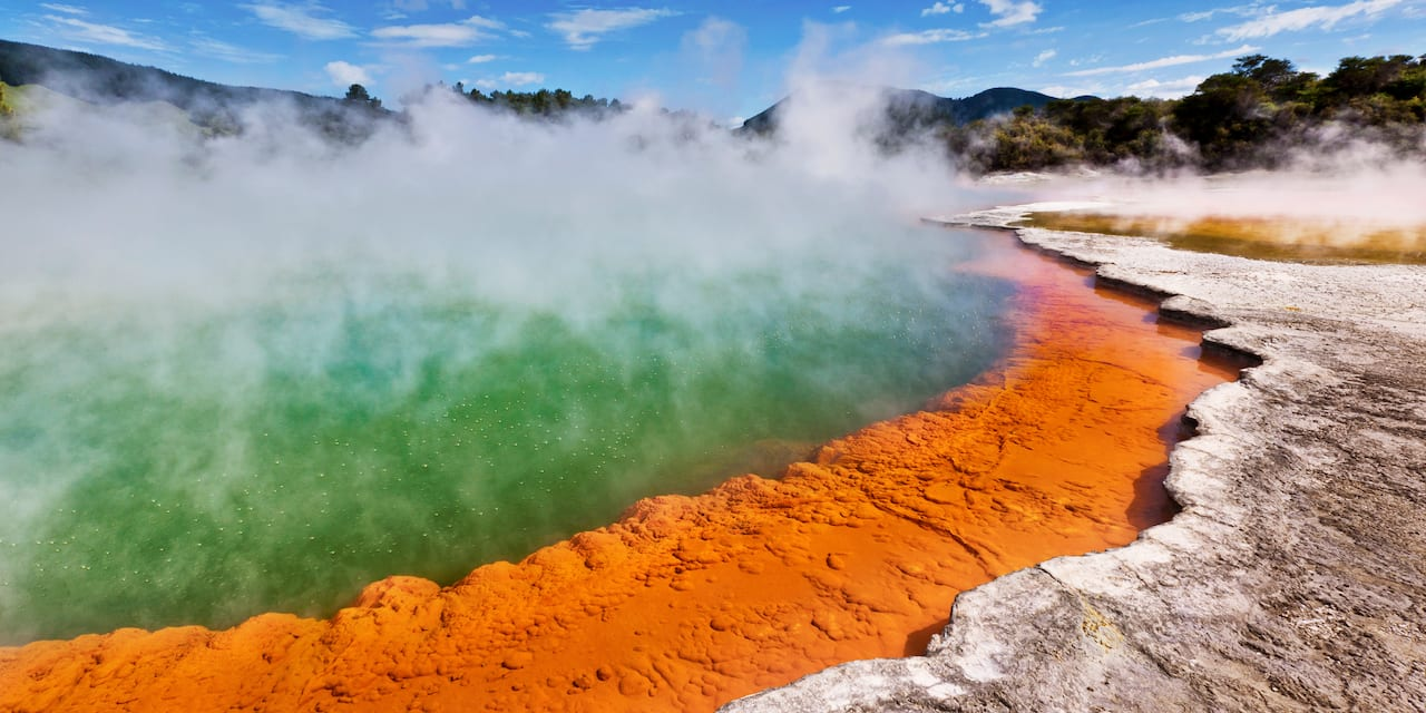Steam rises from a geothermal hot pool