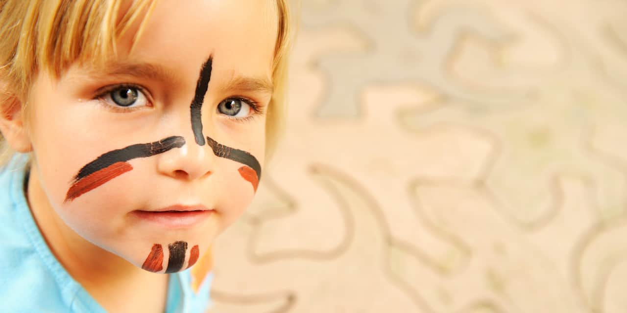 A little boy with a painted face