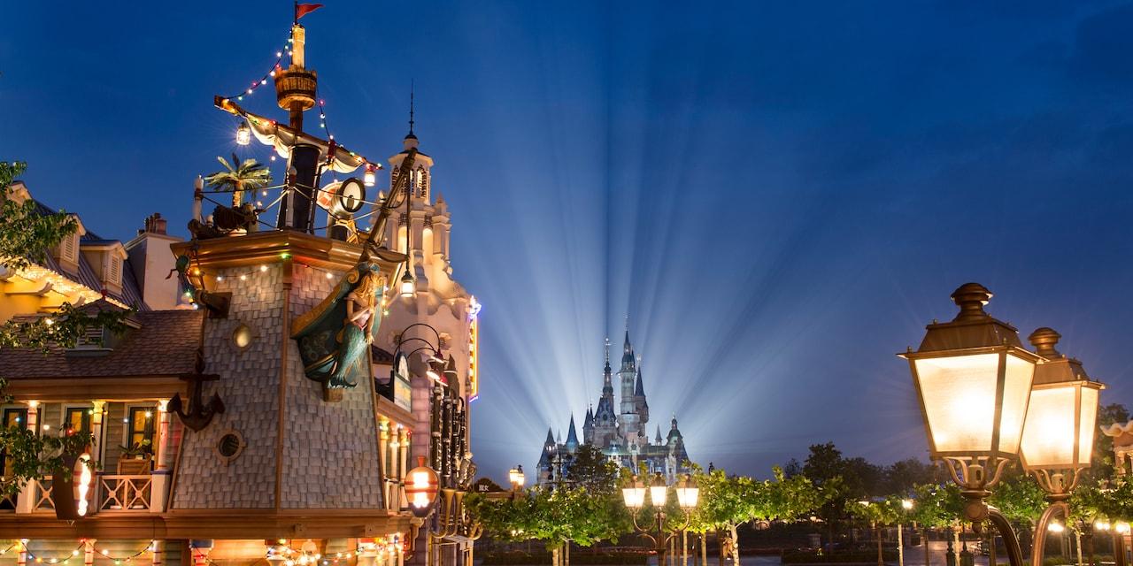 Treasure Cove and Enchanted Storybook Castle are lit up at night at Shanghai Disneyland