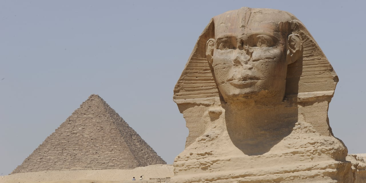 The Great Sphinx of Giza and an Egyptian pyramid