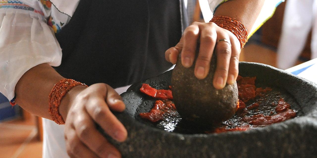A cook prepares a traditional Ecuadorian dish