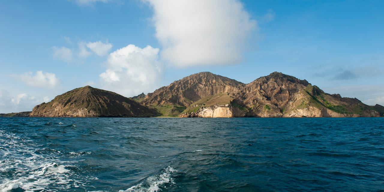 A view of an island mountain range seen from the ocean