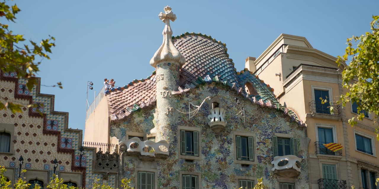 The whimsical Casa Batlló, an apartment building designed by Gaudí in his signature style