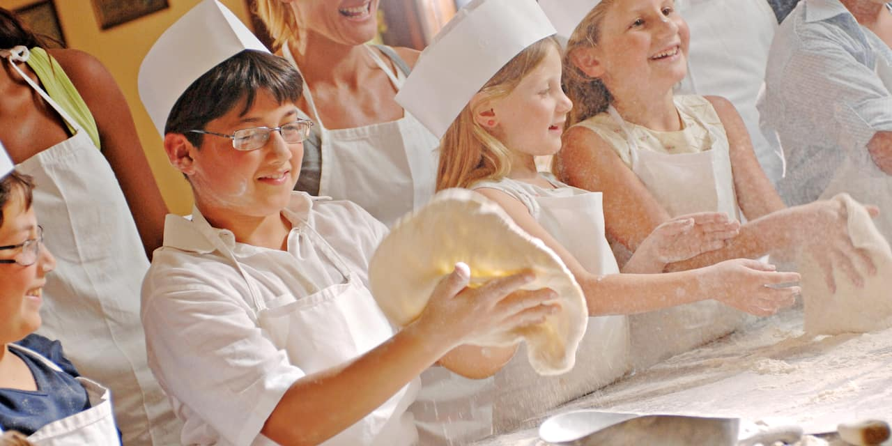 Children learning how to make a pizza crust