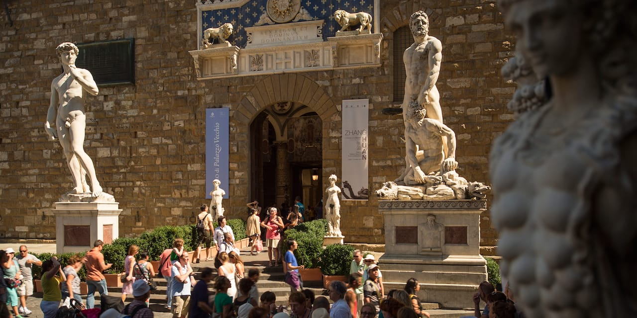 A replica of Michelangelo's David and another statue outside the Palazzo Vecchio in Florence, Italy