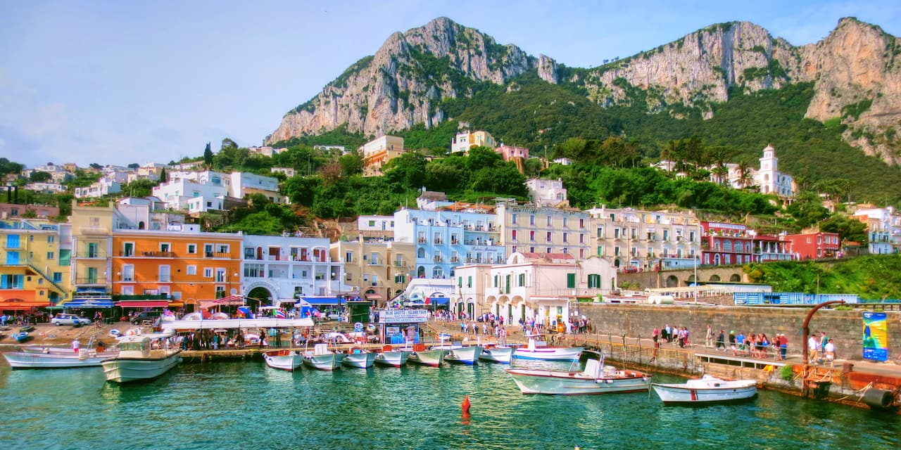 Colorful houses of Capri line the mountainside next to the sea