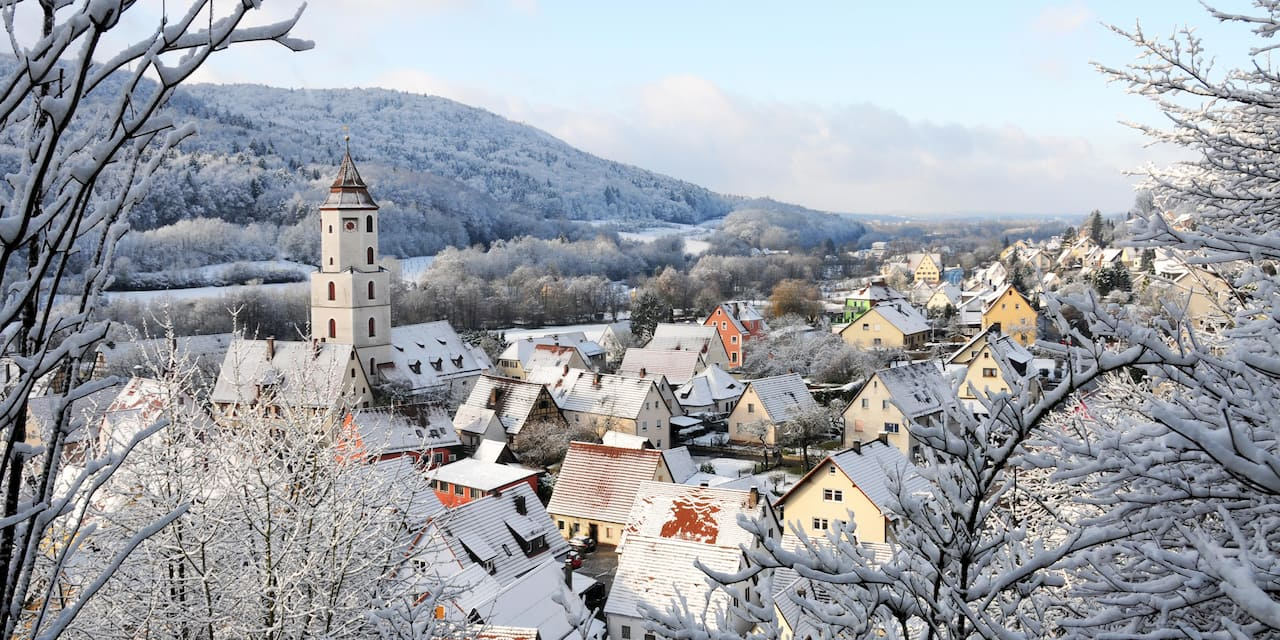 Snowy rooftops on houses in a valley