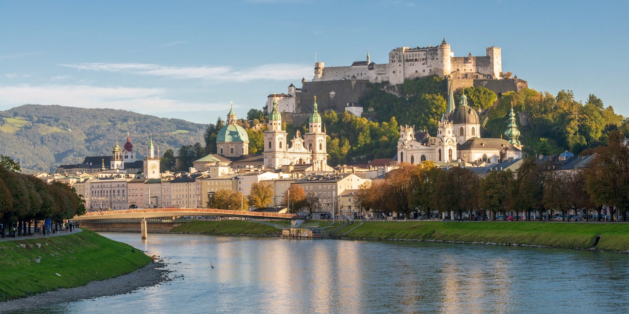 Salzburg and a castle on a hill overlook the Danube River