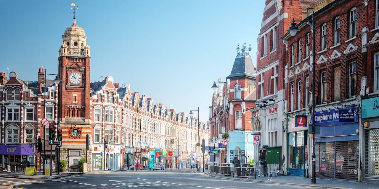 London neighborhood with historical buildings and modern storefronts on street level