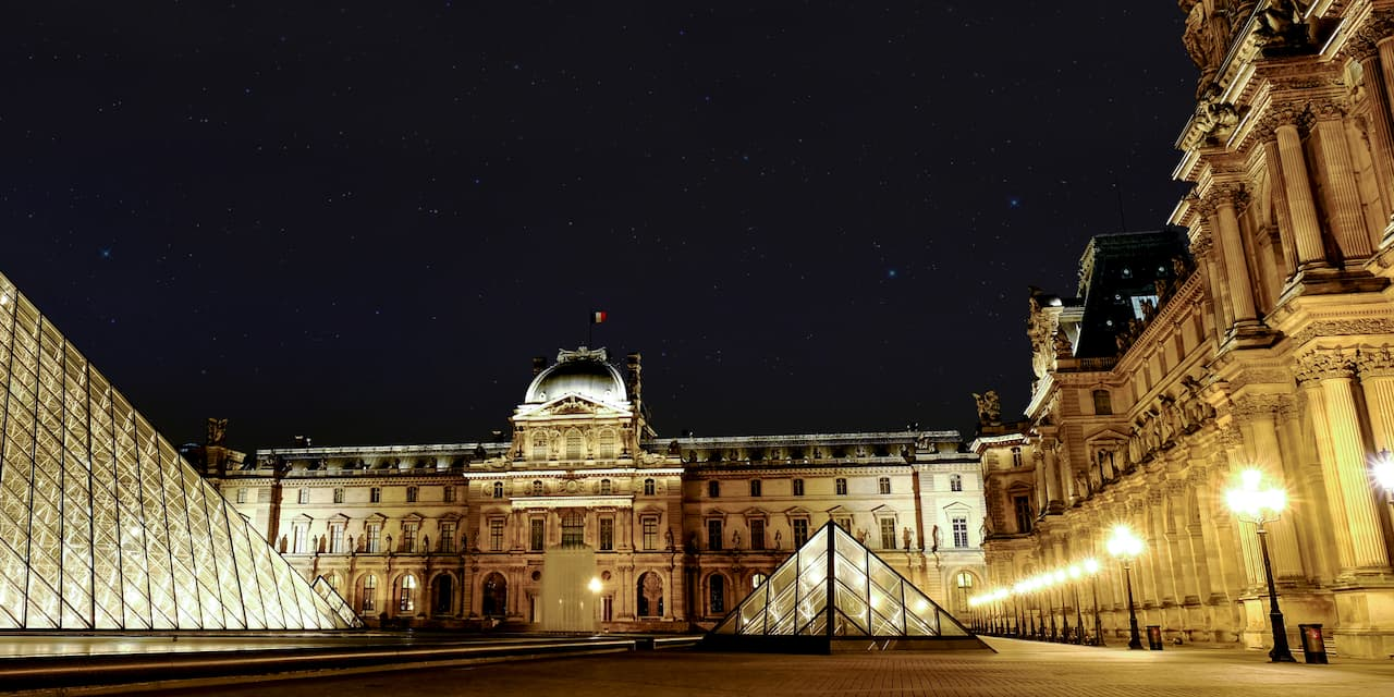 The Louvre Museum and its Pyramid at night