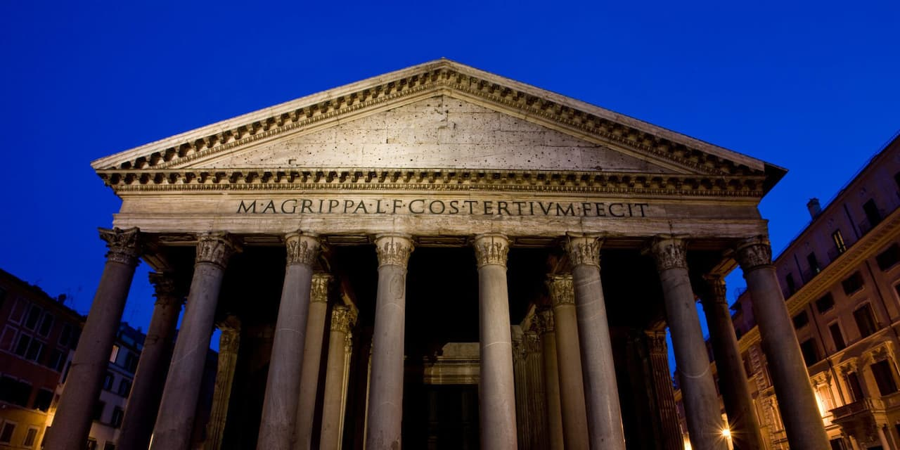 View of the columns and front side of the Pantheon in Rome at night