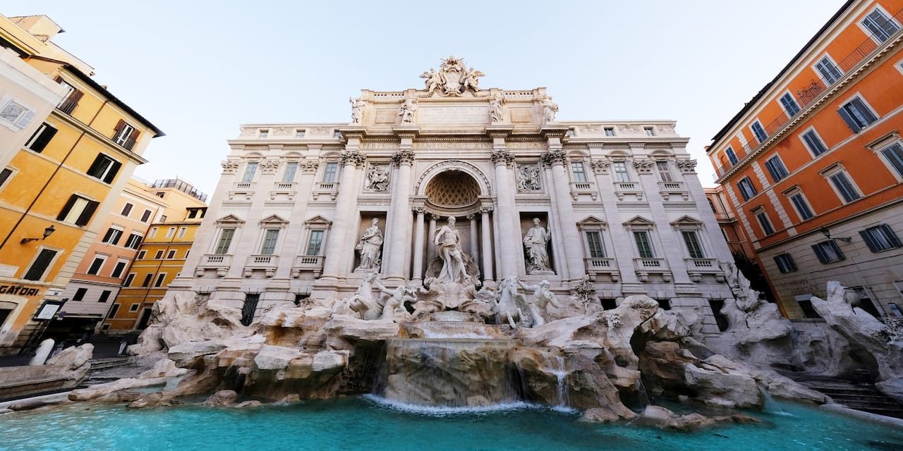 Water cascading from the Trevi Fountain in Rome