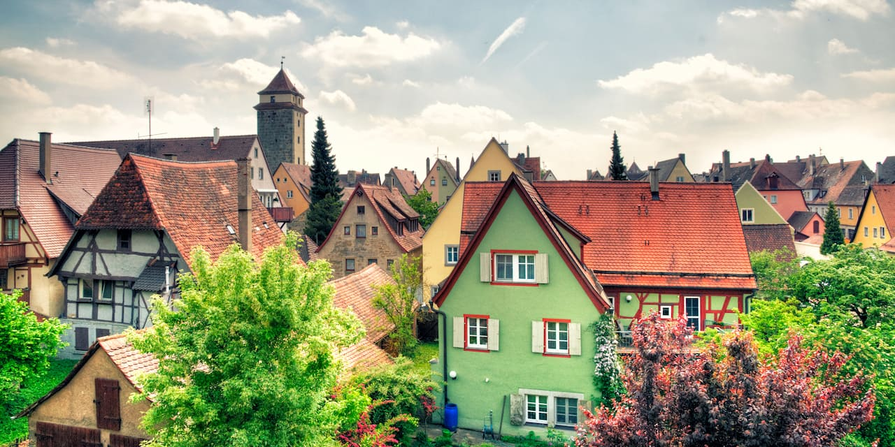 Tudor-style buildings and shops line the cobblestone streets of Rothenburg's medieval old town area