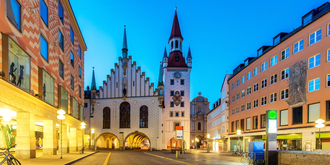 A street-level view of the largest public square in Munich featuring the spired Old Town Hall