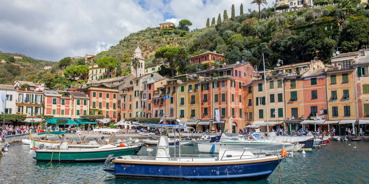 Boats anchored in the harbor of Portofino, Italy