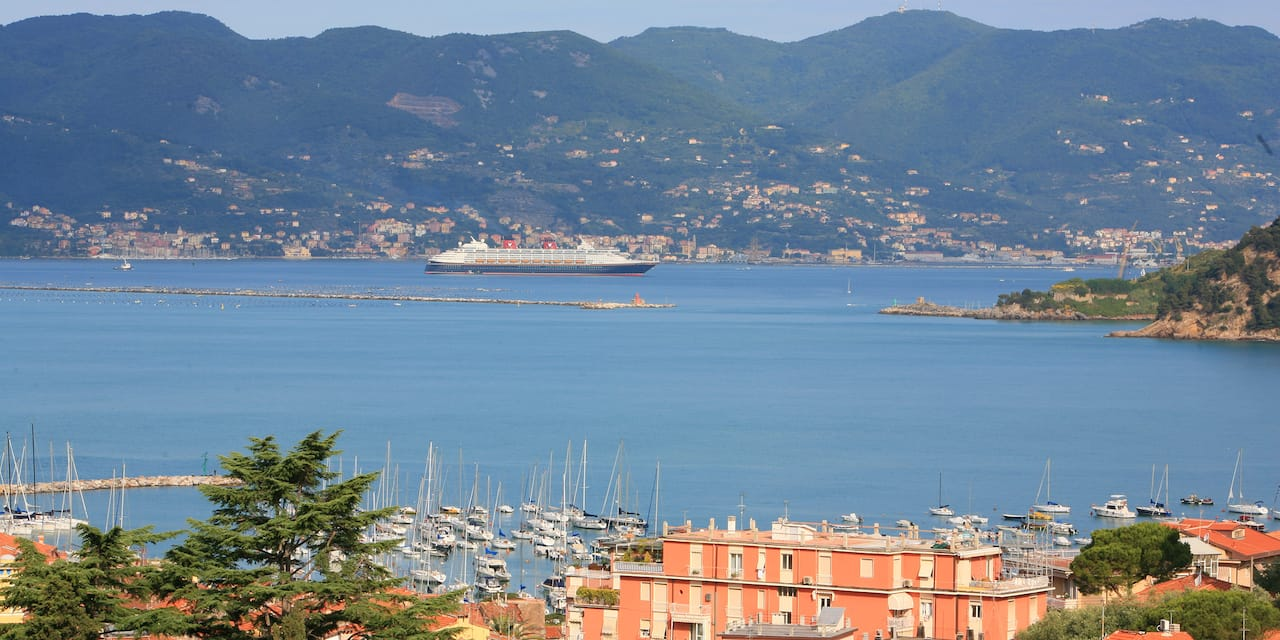 The Disney Magic cruise ship sails near the hilly shores of Florence, Italy