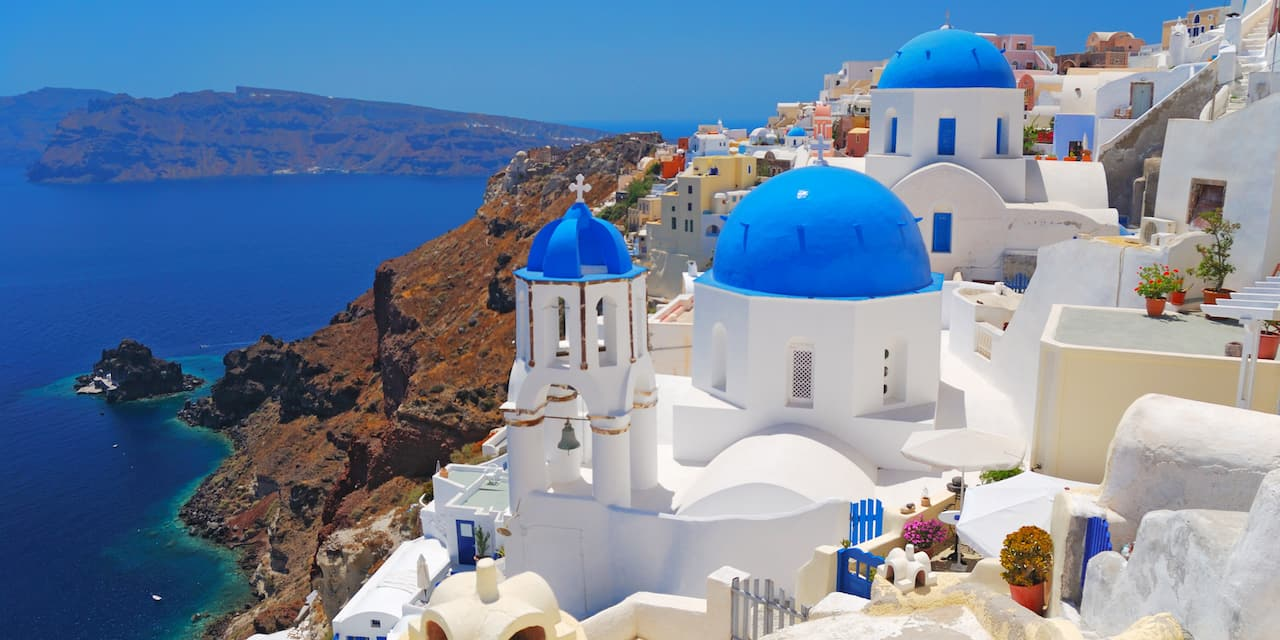 Buildings built into the cliffs of Santorini, Greece overlooking the Aegean Sea