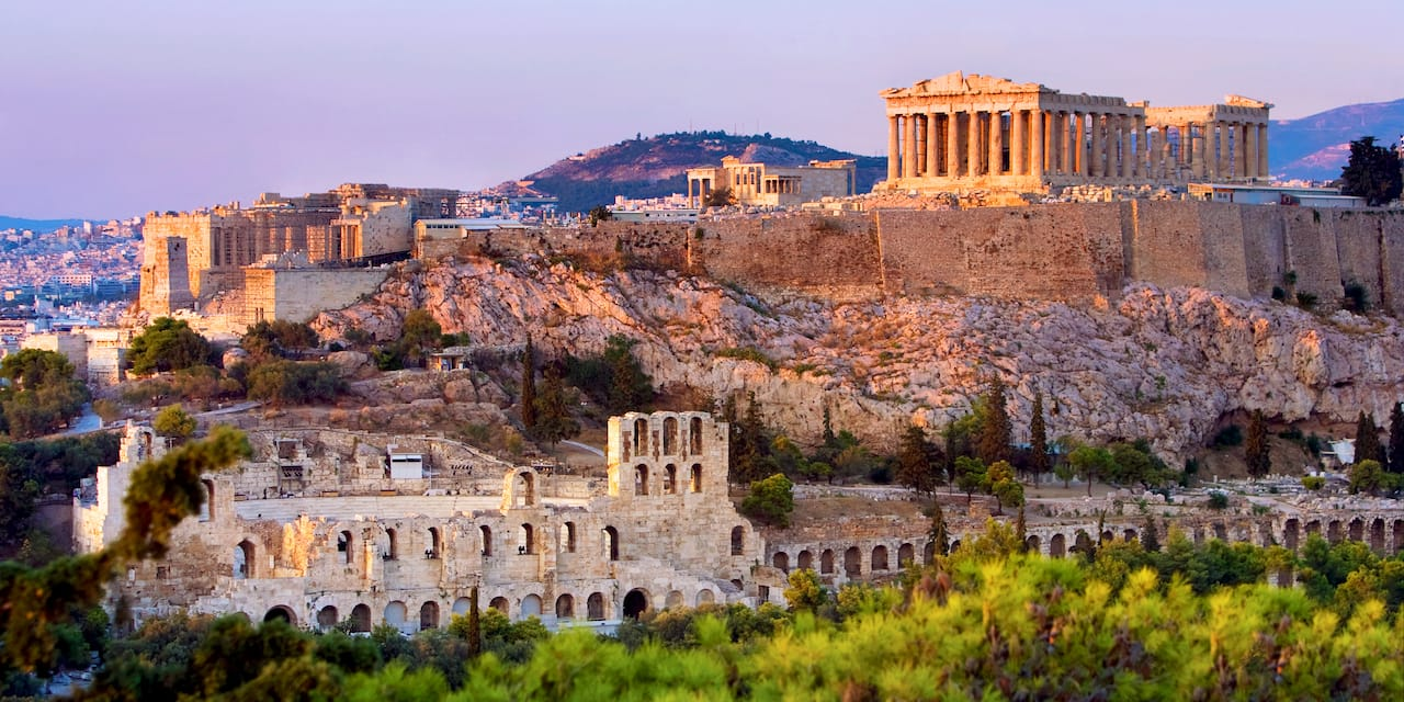 The Parthenon atop the Acropolis looks over the city of Athens, Greece