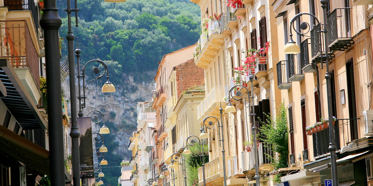 A Naples street lined with lamp posts