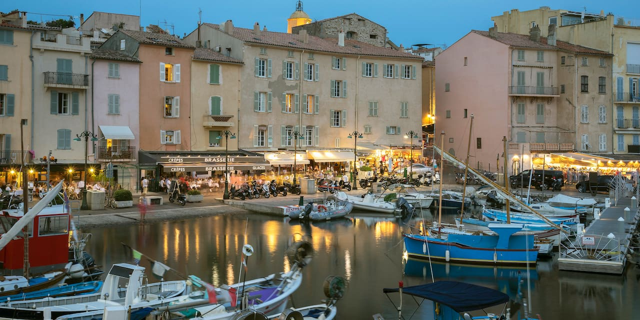 Boats fill the dock slips at a Saint-Tropez harbor in the evening