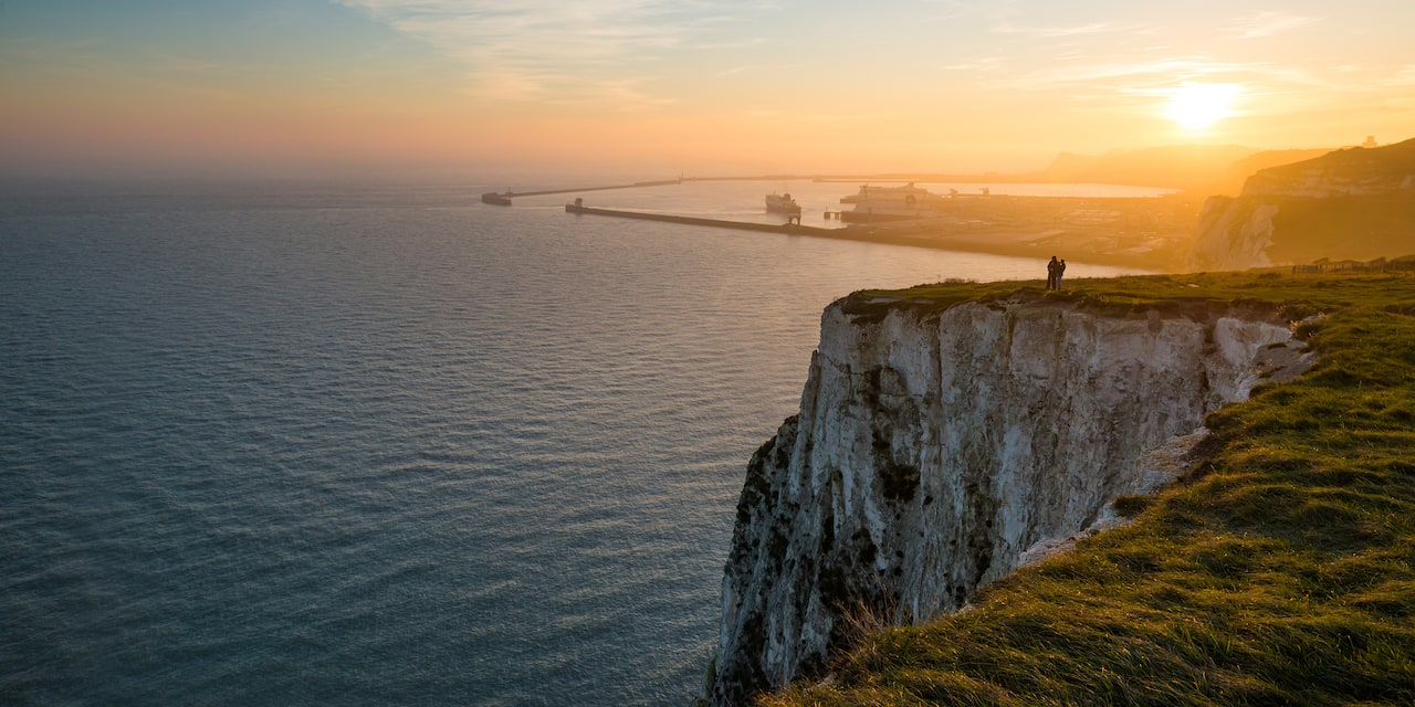 A cliff overlooking the sea at sunset in Dover, England